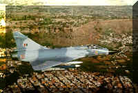 A Mirage 2000 flying across the backdrop of the historic Gwalior Fort